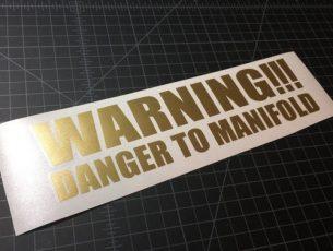 warning danger to manifold gold